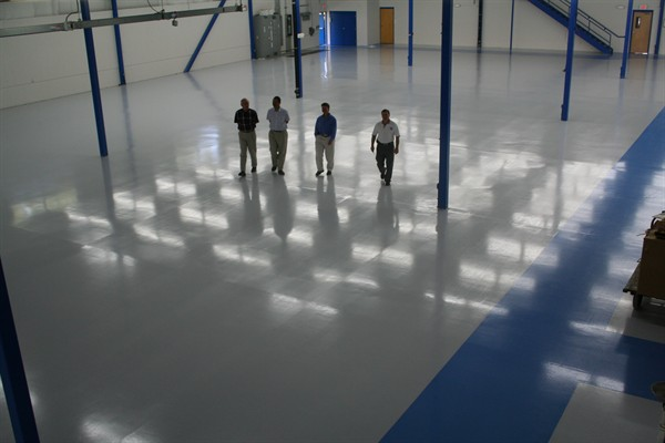 How do antimicrobial floor coatings work?